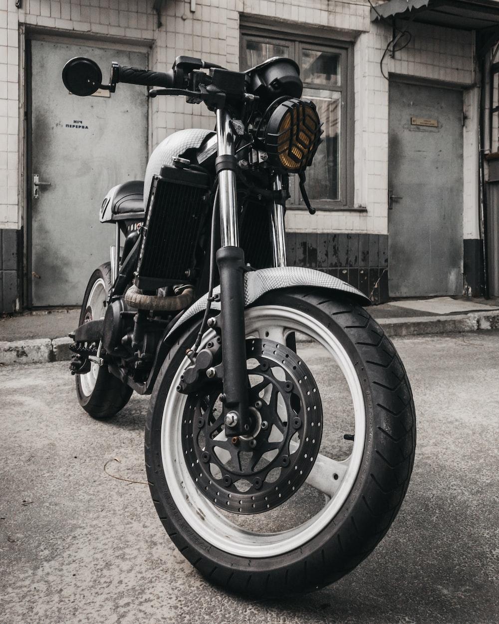 black motorcycle parking near building