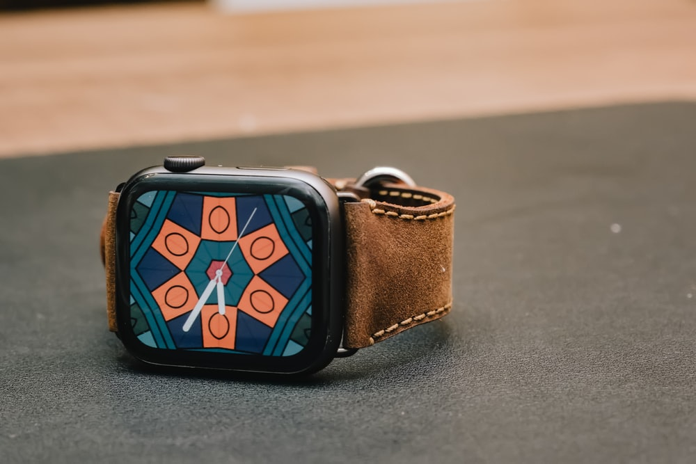 space gray aluminum case Apple Watch with brown leather band
