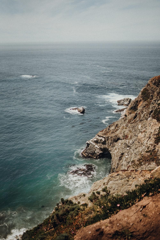brown cliff near ocean