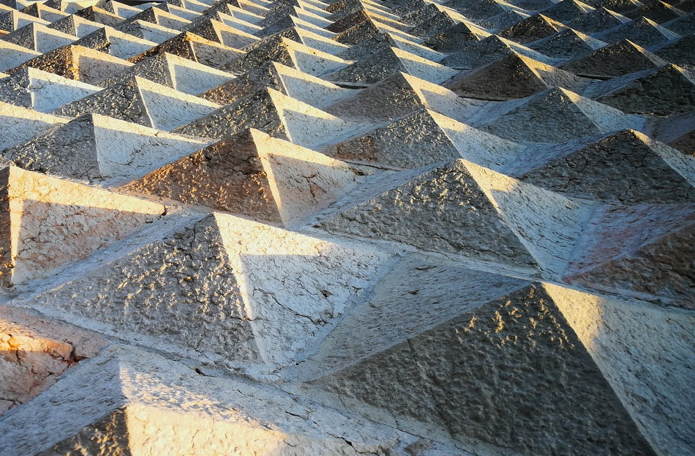 gray cement small pyramids surface