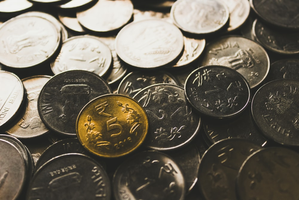 round silver-colored coin collection close-up photography