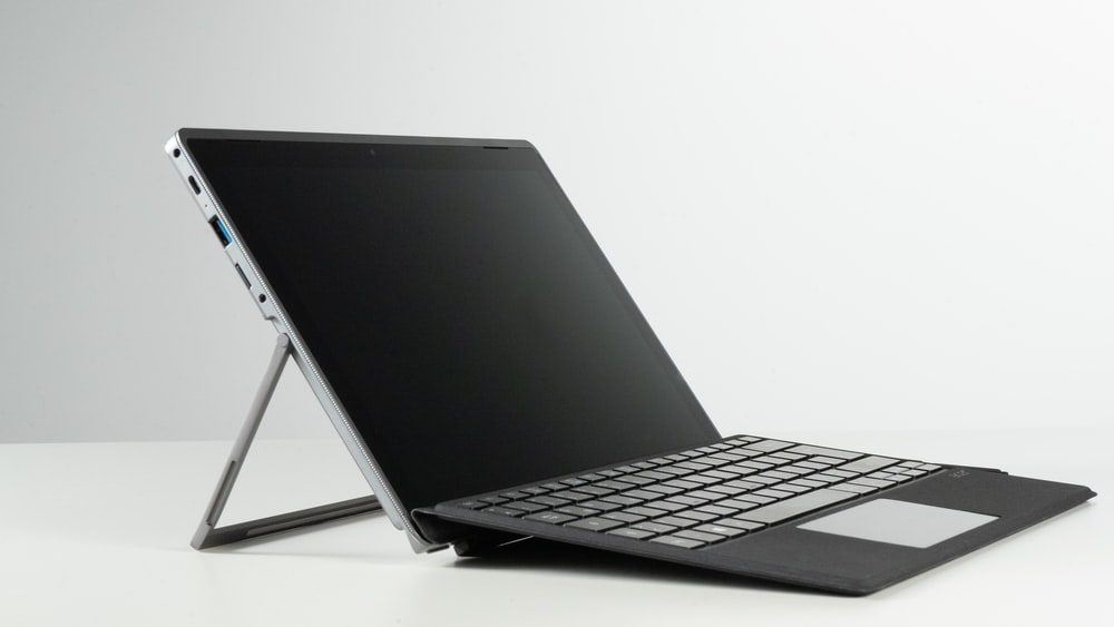 black and gray laptop computer with black screen