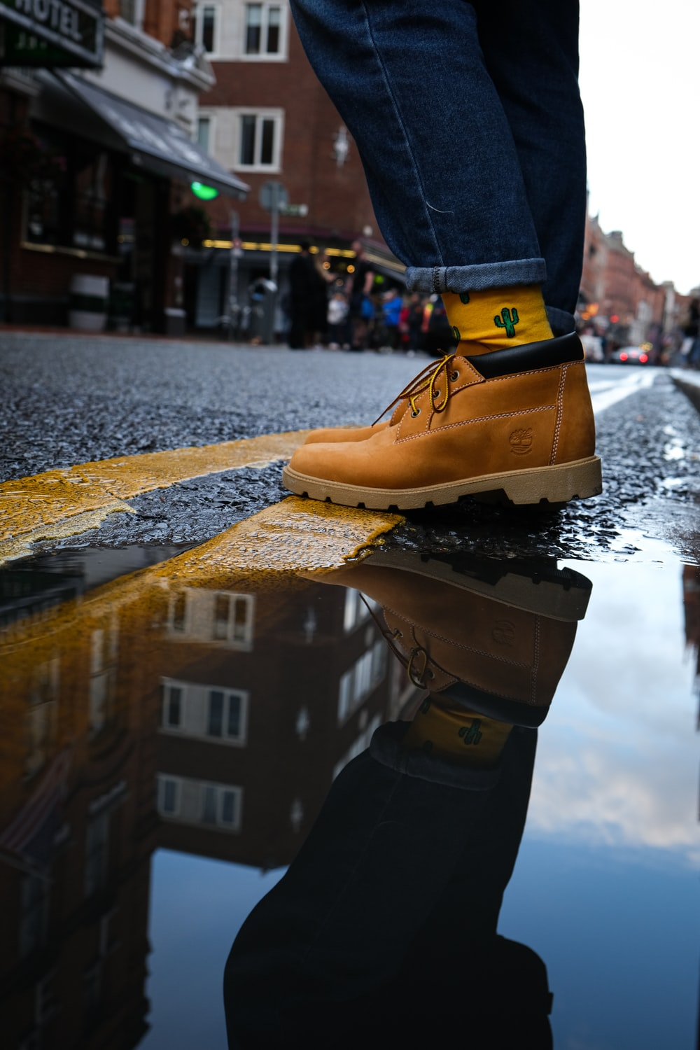 person standing on water puddle