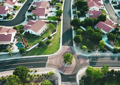 Drone shot looking forward in a suburb.