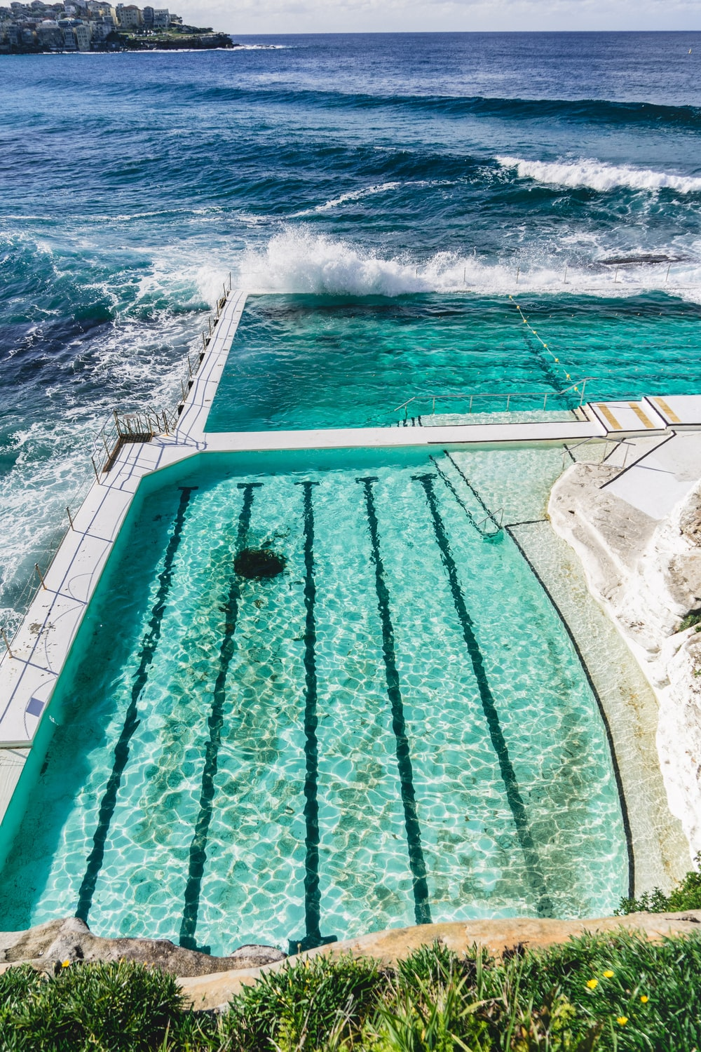 white and teal swimming pool