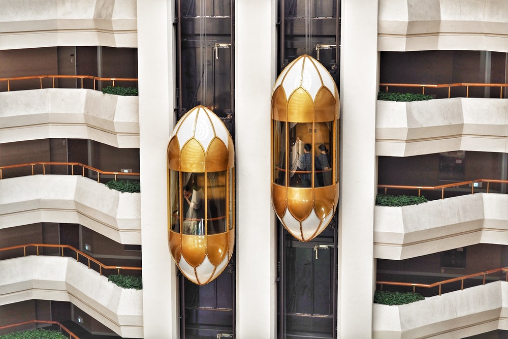 two gold capsule elevator