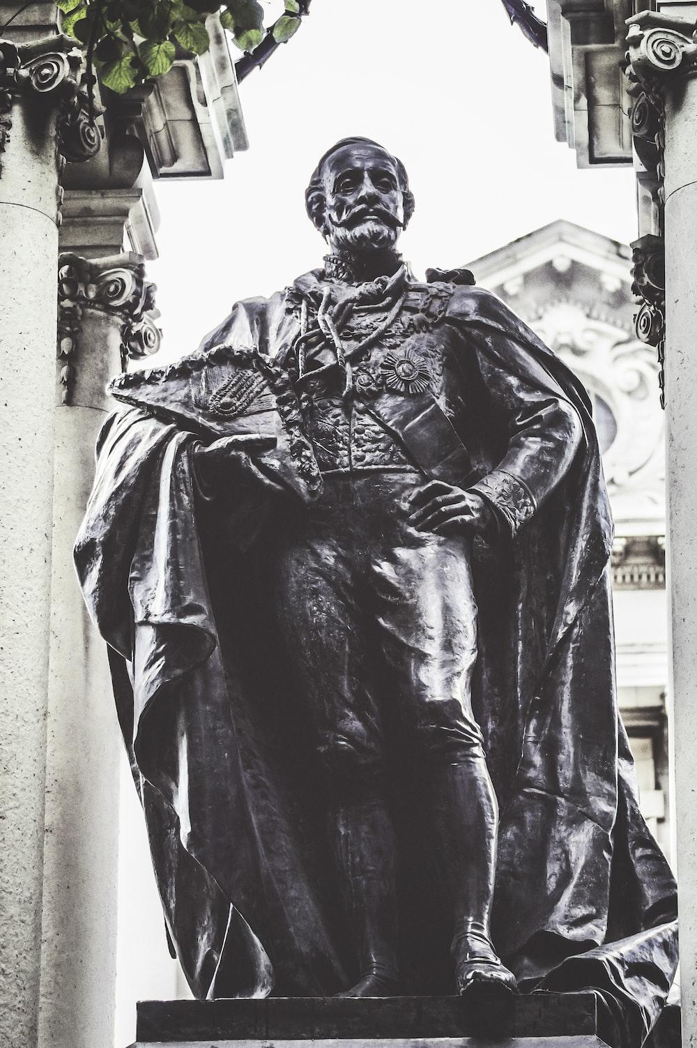 man wearing cape statue