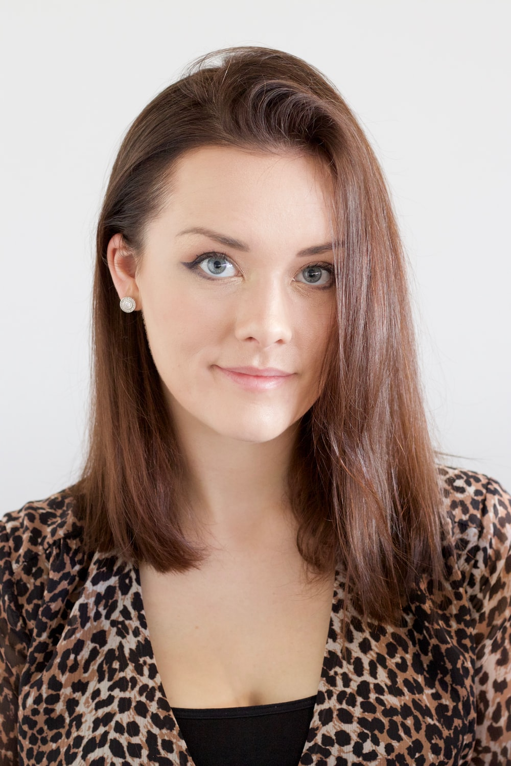 woman wearing brown and black leopard top