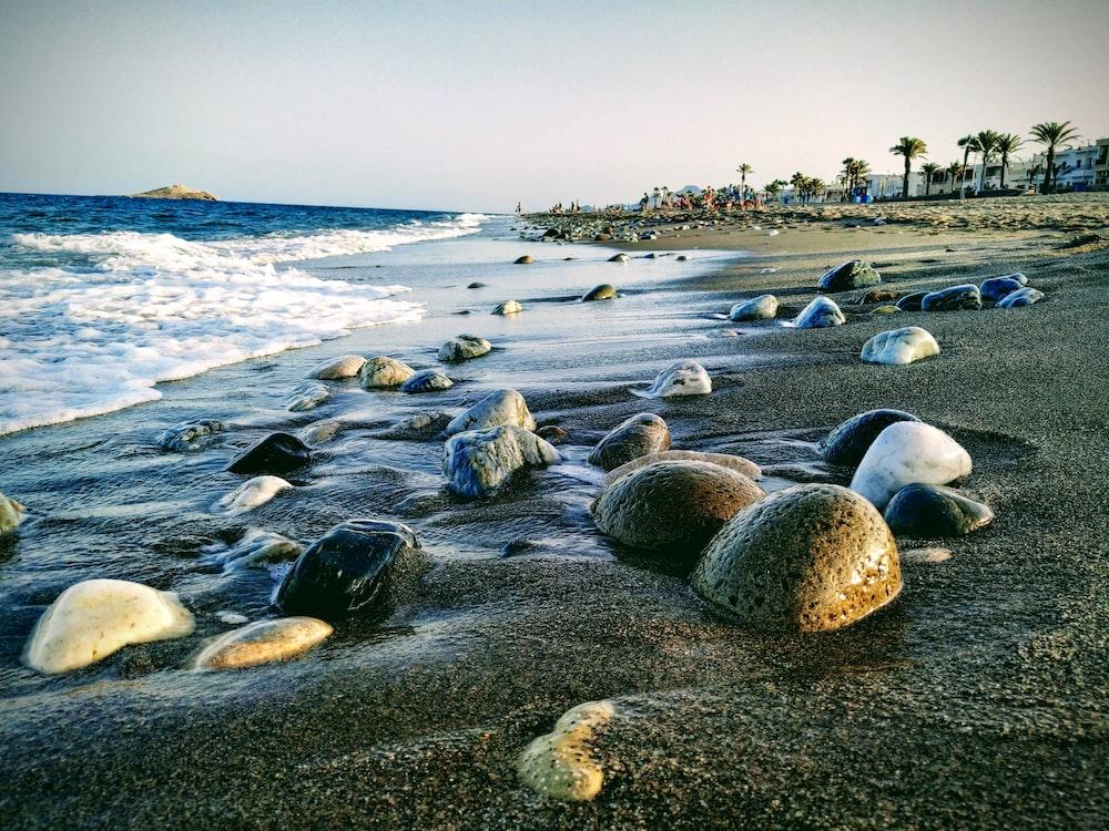 black and white stones on seashores