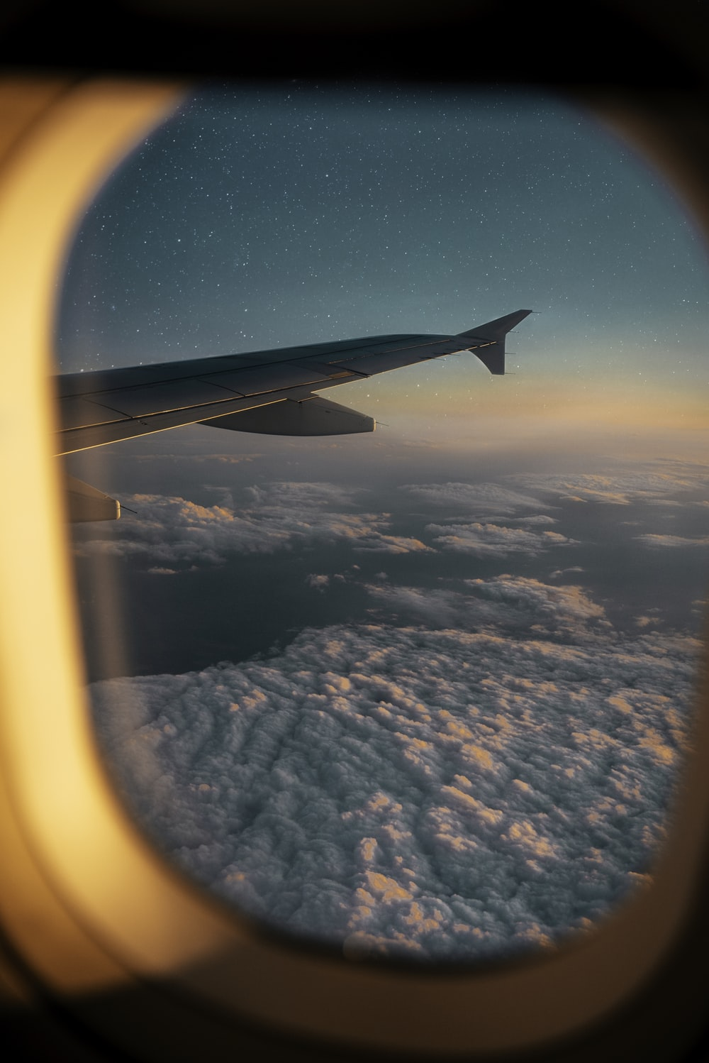 airplane window photography of white clouds