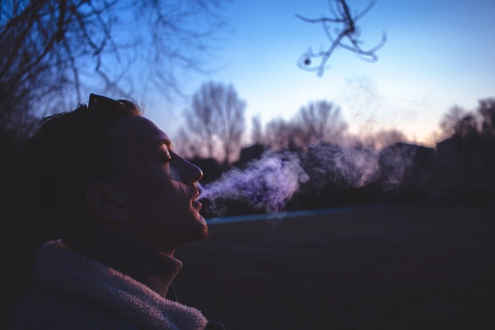 man smoking during golden hour