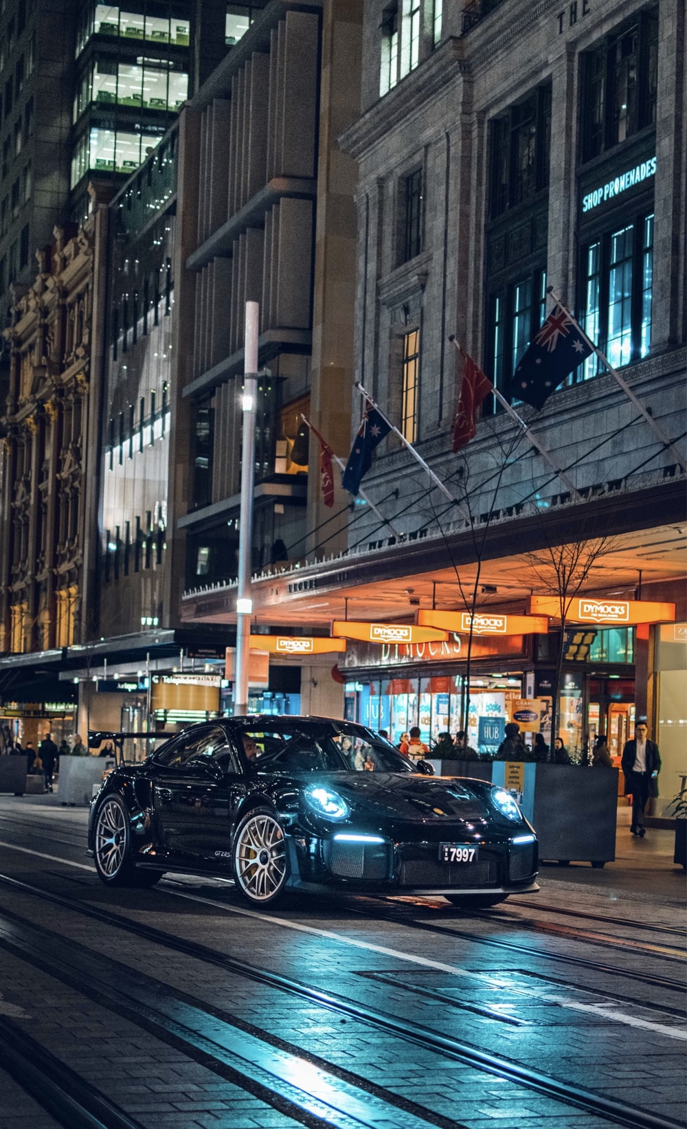 black car on paved road
