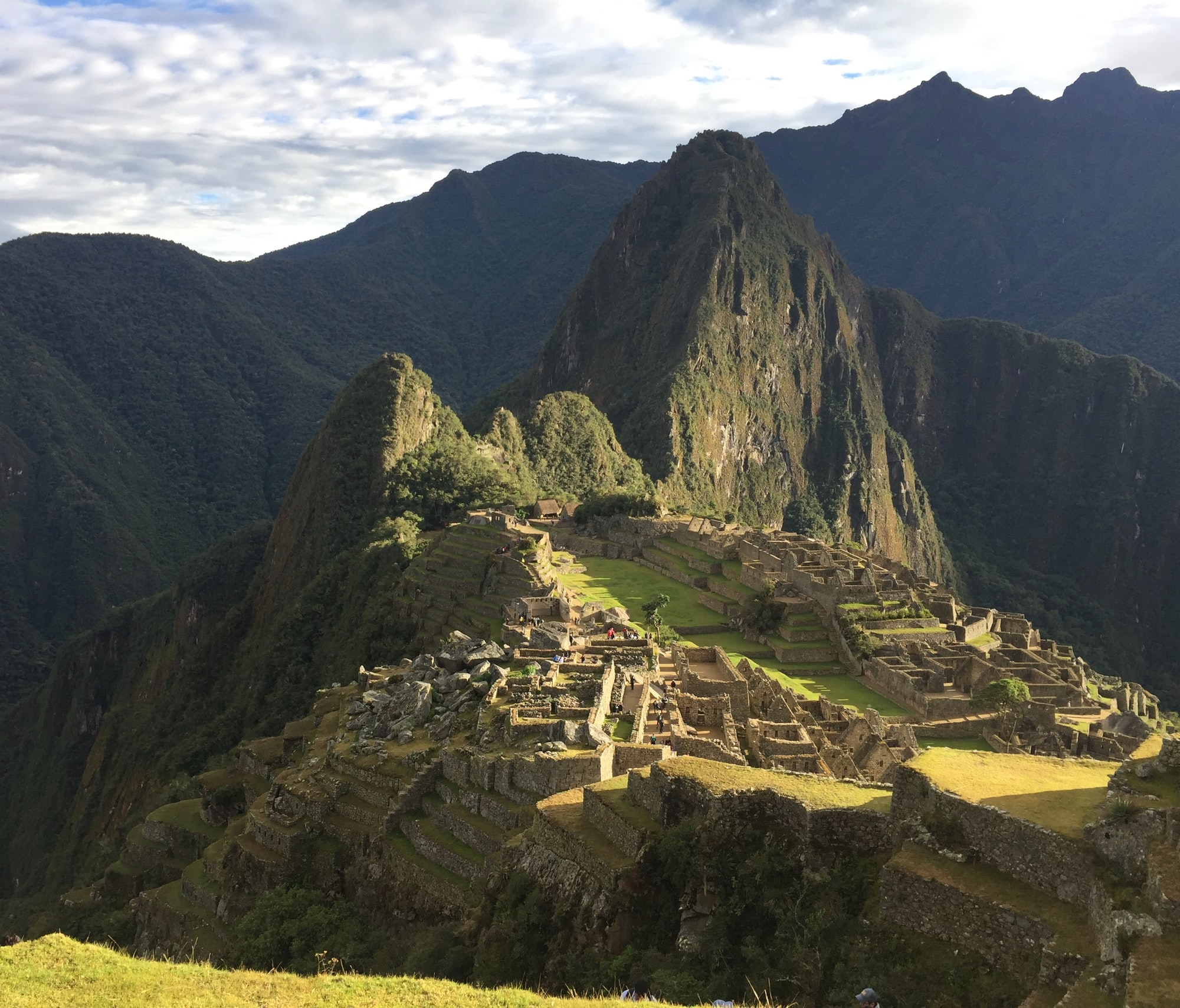 The Inca Citadel atop Machu Picchu with Huayna Picchu towering over it.