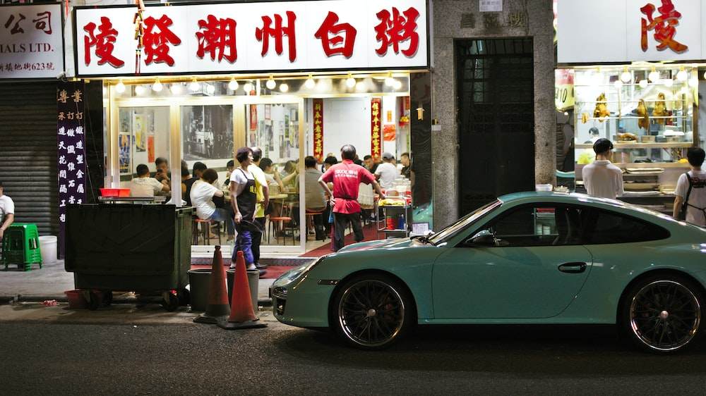 teal coupe outside store