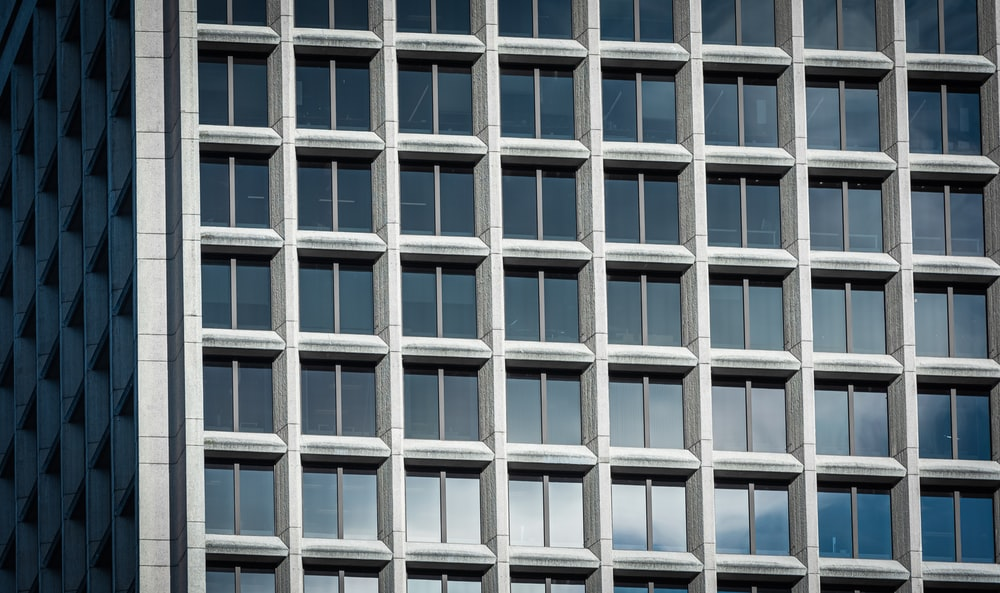 blue and white glass high-rise building