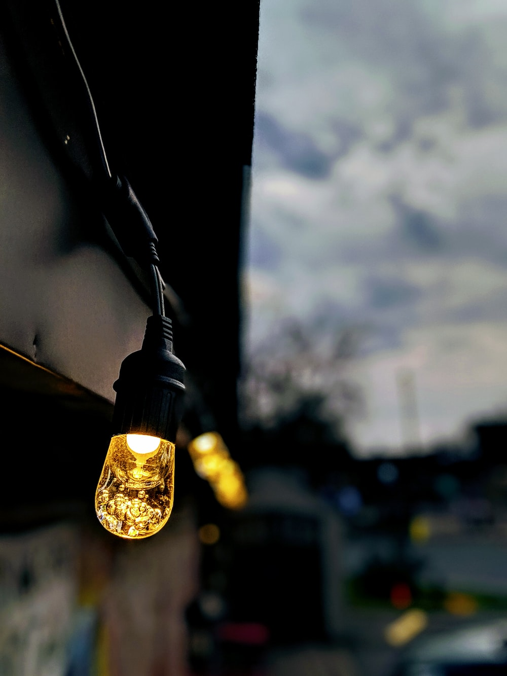 lighted bulbs in selective focus photo