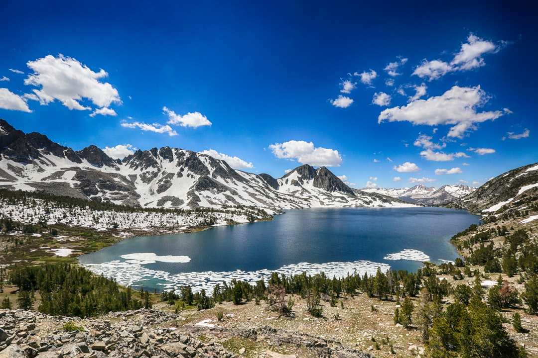 When we crested the snow covered saddle to this lake in the Mammoth Lakes region of California, we had a view from the side of the lake. I had to hike another half mile over rough, rocky terrain to get a vantage to take in the whole lake. But it was worth it to get this great view with tons of snow in mid July.