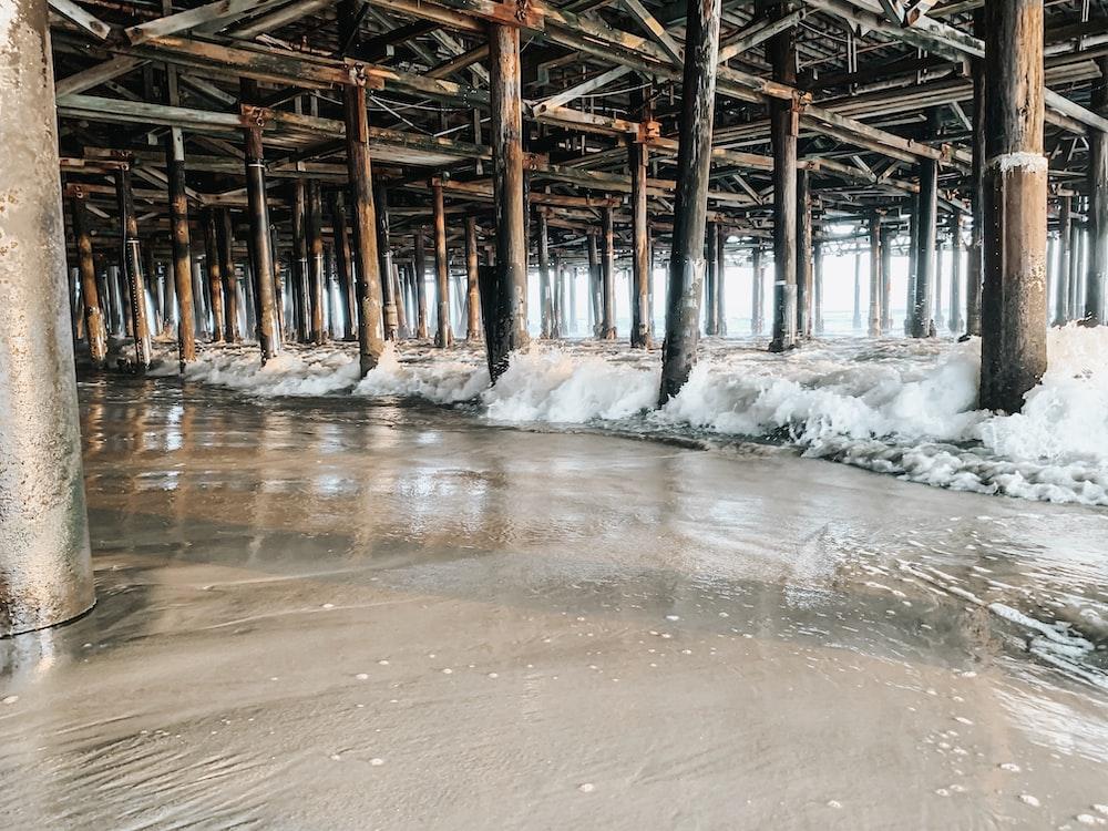 brown bridge on seashore