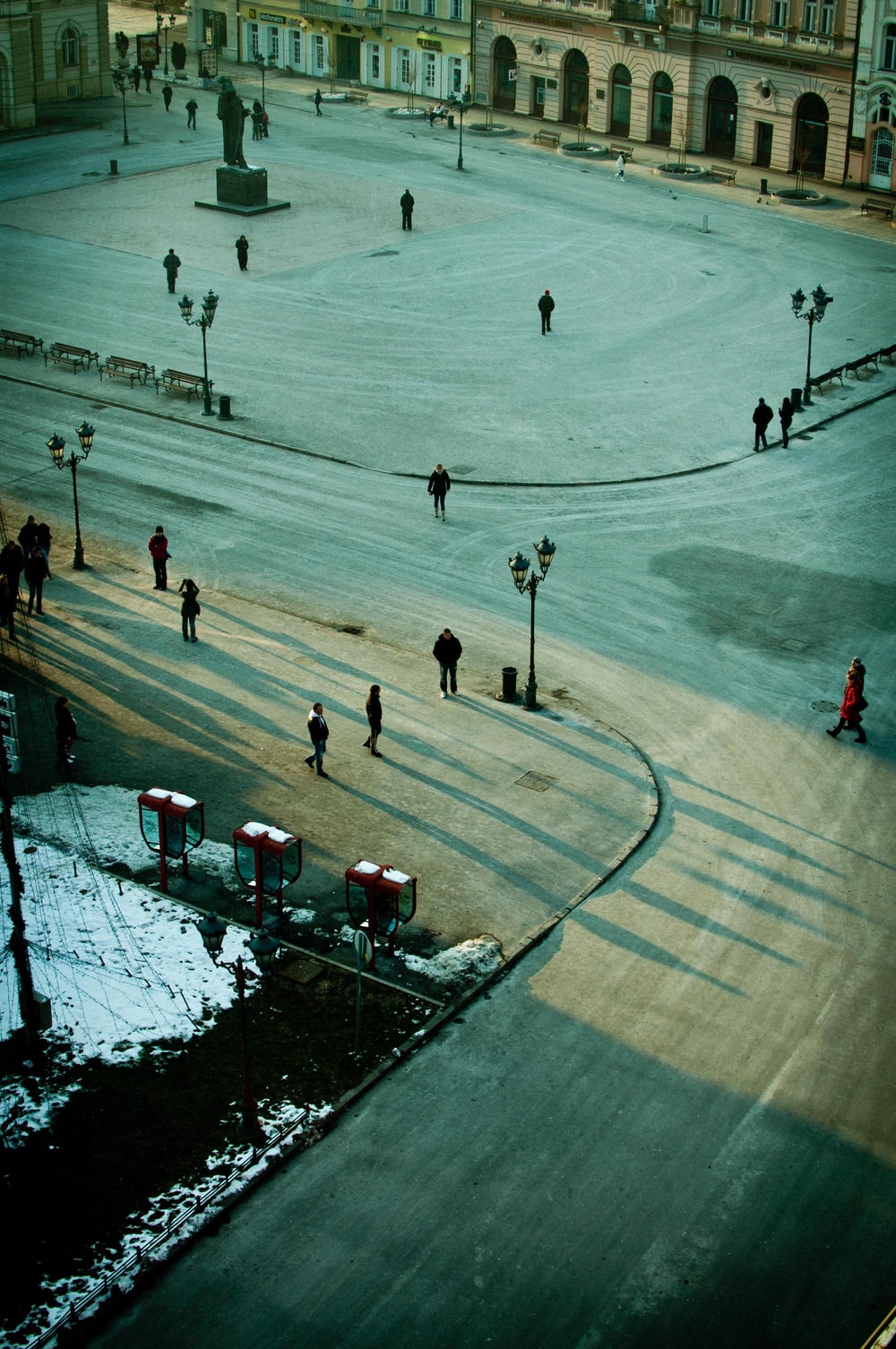 aerial photography of people on gray road