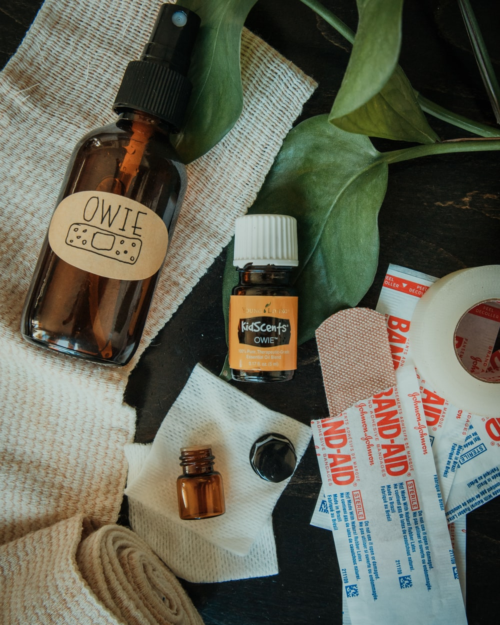 flat lay photo of band-aids and ointment bottle