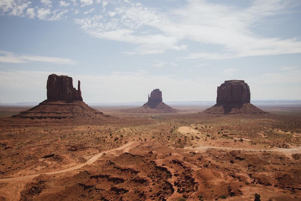 three brown buttes in desert