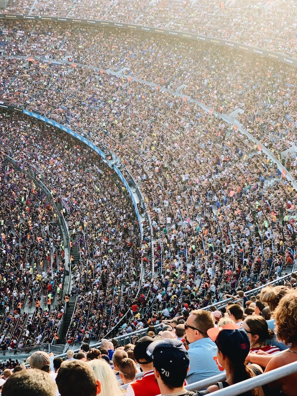 people sitting inside stadium seats