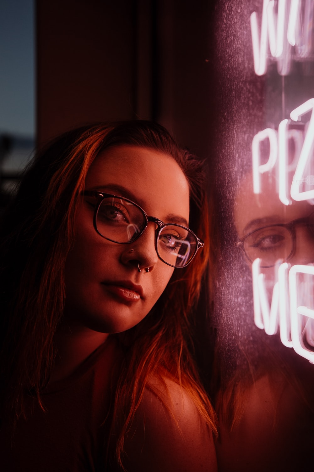 woman near NEON signage