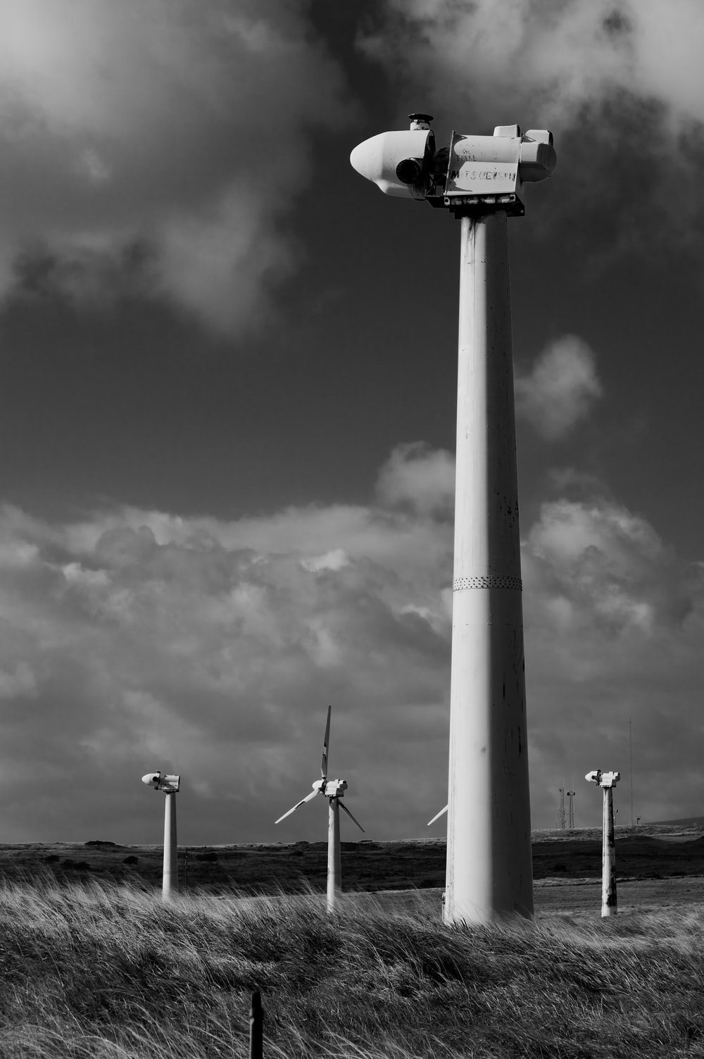 grayscale photography of windmills