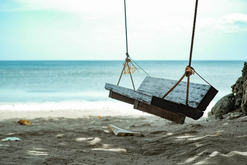 brown wooden swing seat
