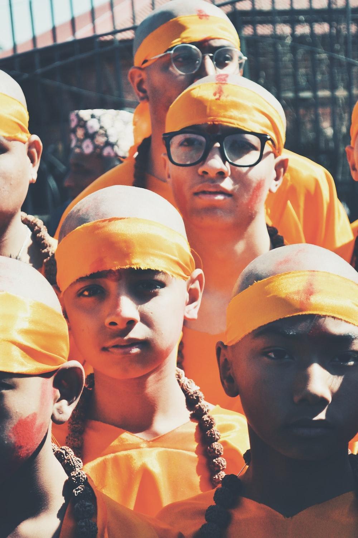 boy wearing orange headband