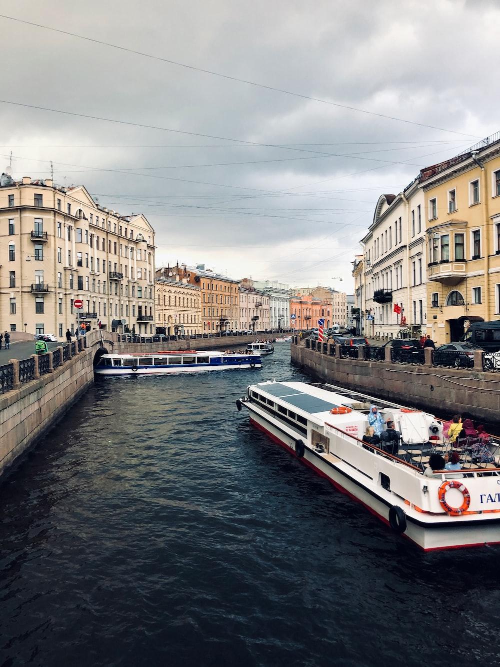 boat in body of water between buildings