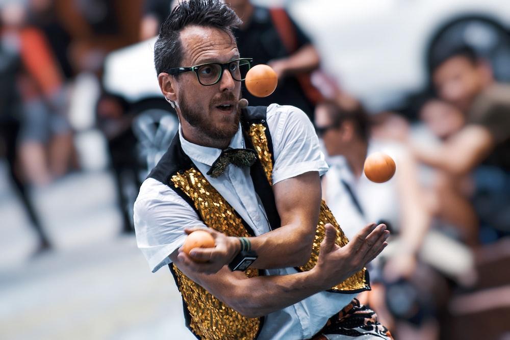 selected focus photogrpahy of man playing balls