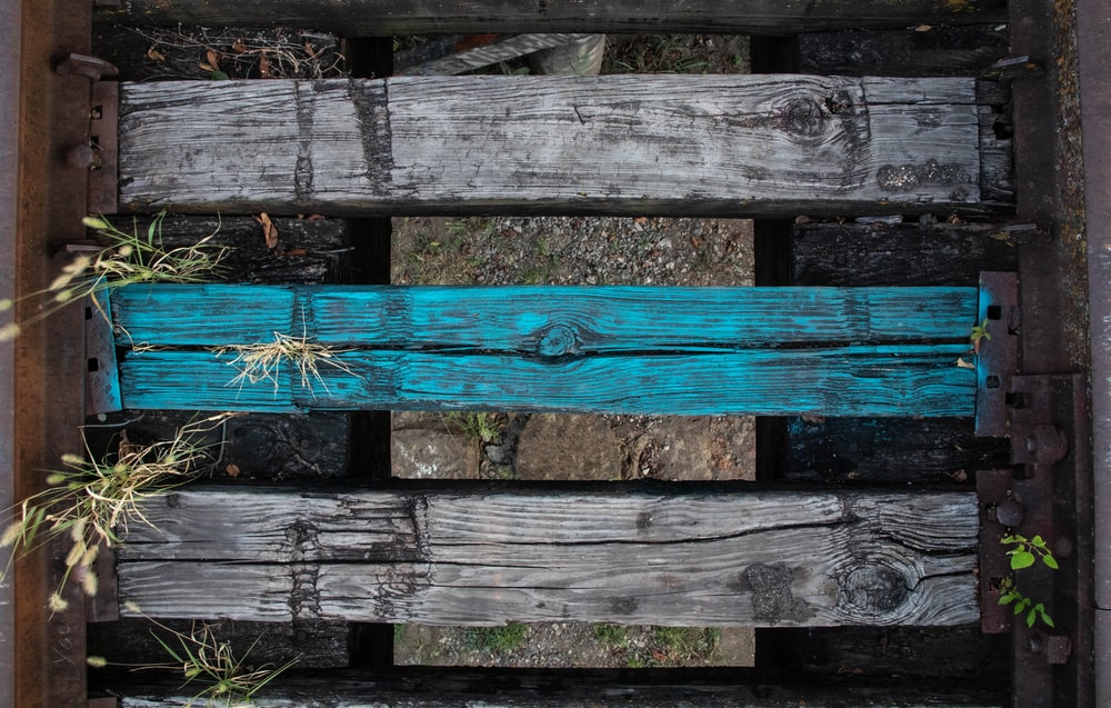 black and blue wooden rack close-up photography