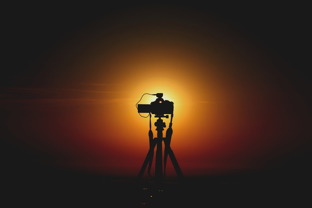 silhouette of camera in tripod