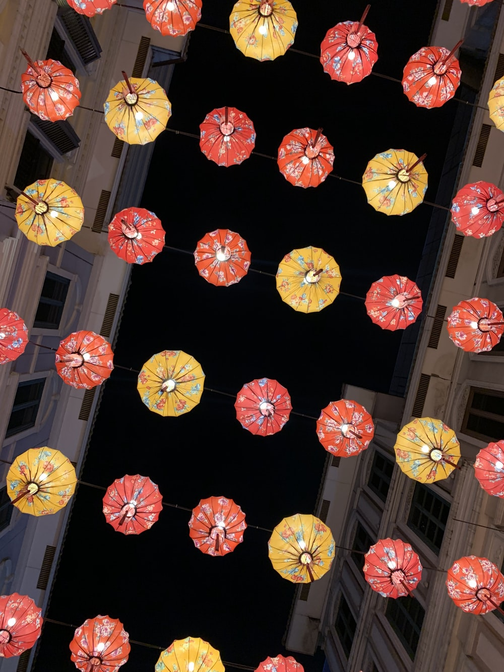 bunch of red and yellow paper lanterns during nighttime
