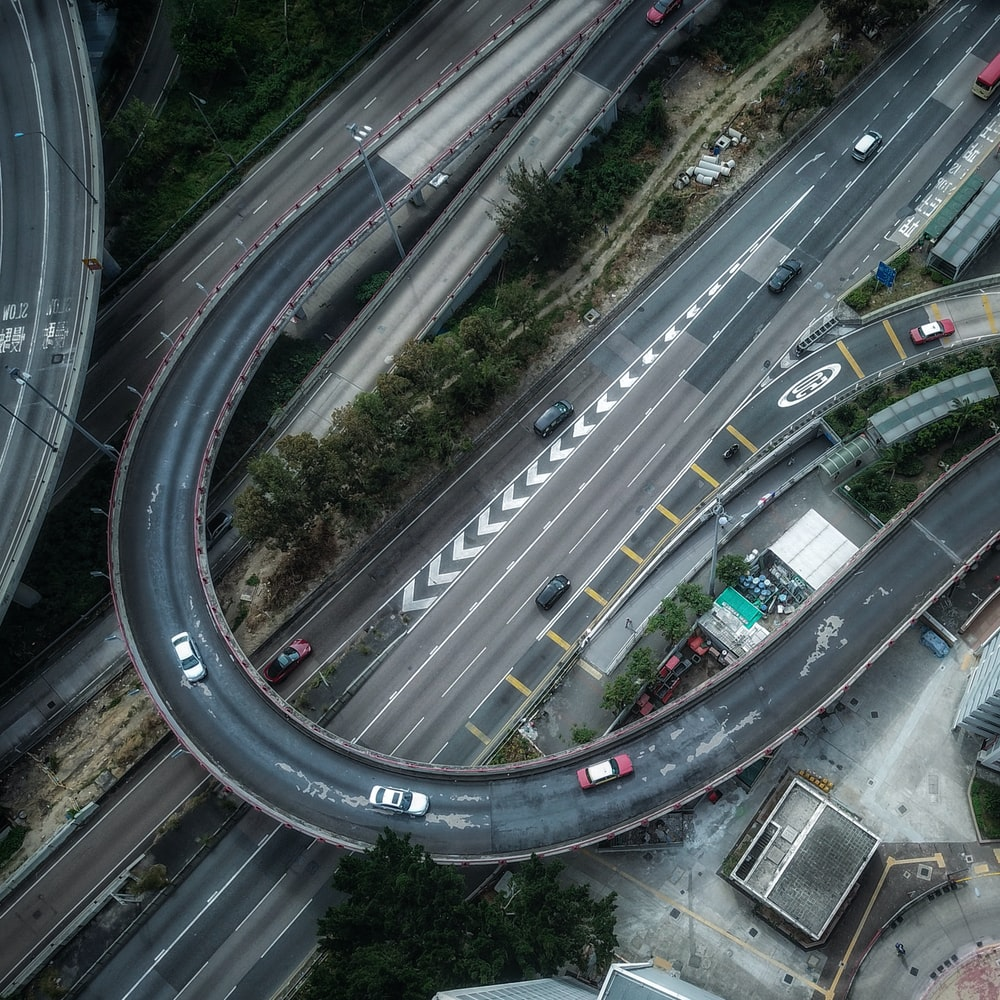 aerial photography of cars on road