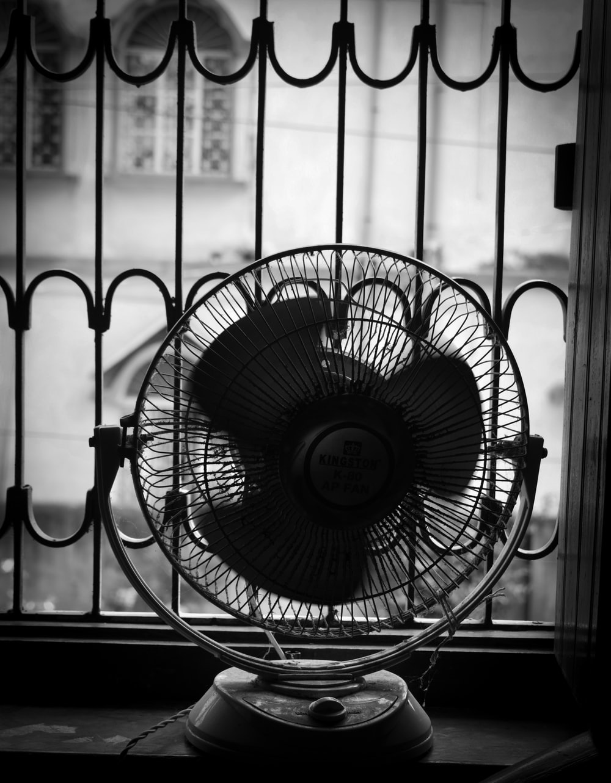 gray pedestal fan