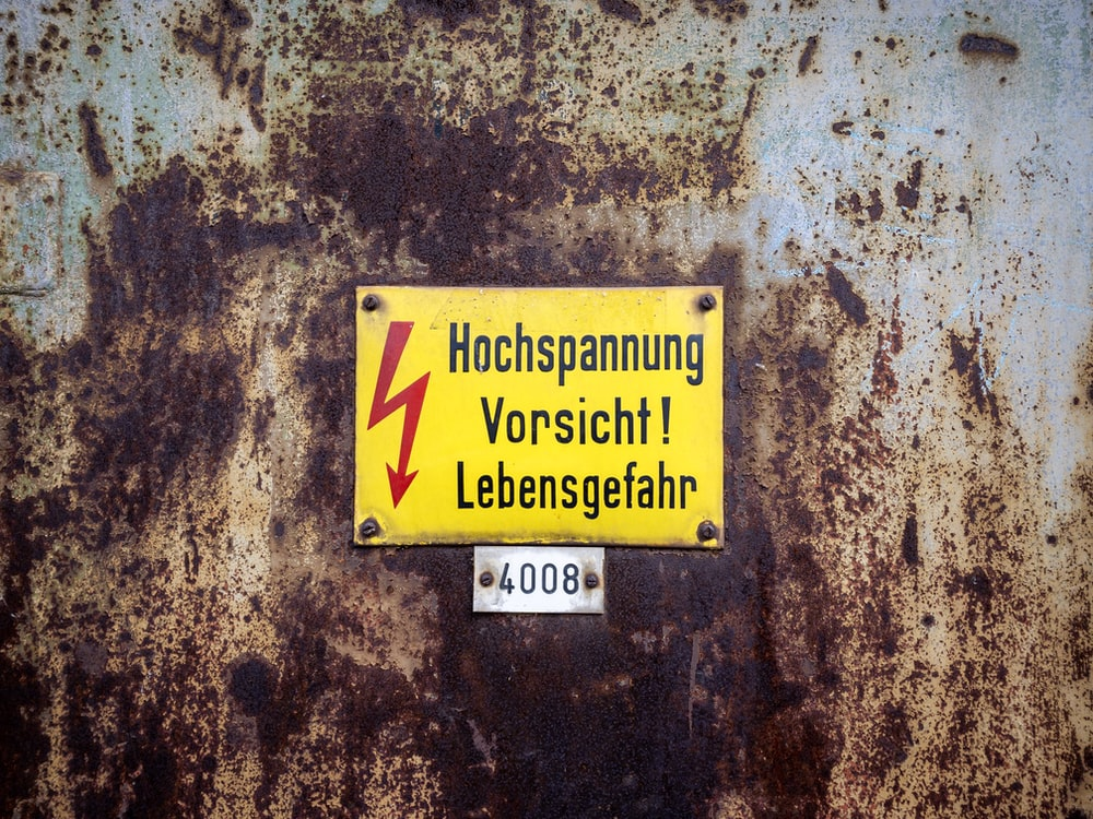 yellow voltage metal sign