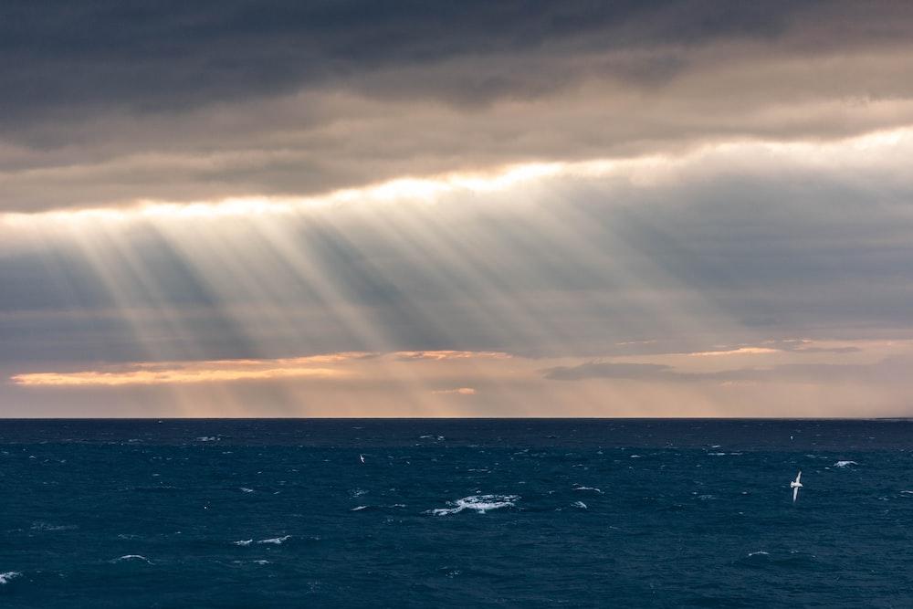sun ray hitting body of water