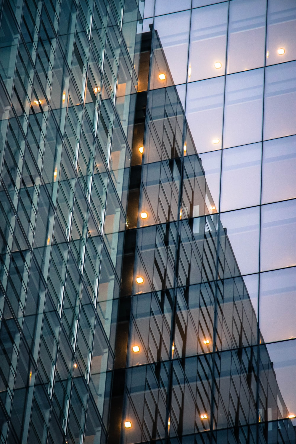 low-angle photography of curtain wall high rise building