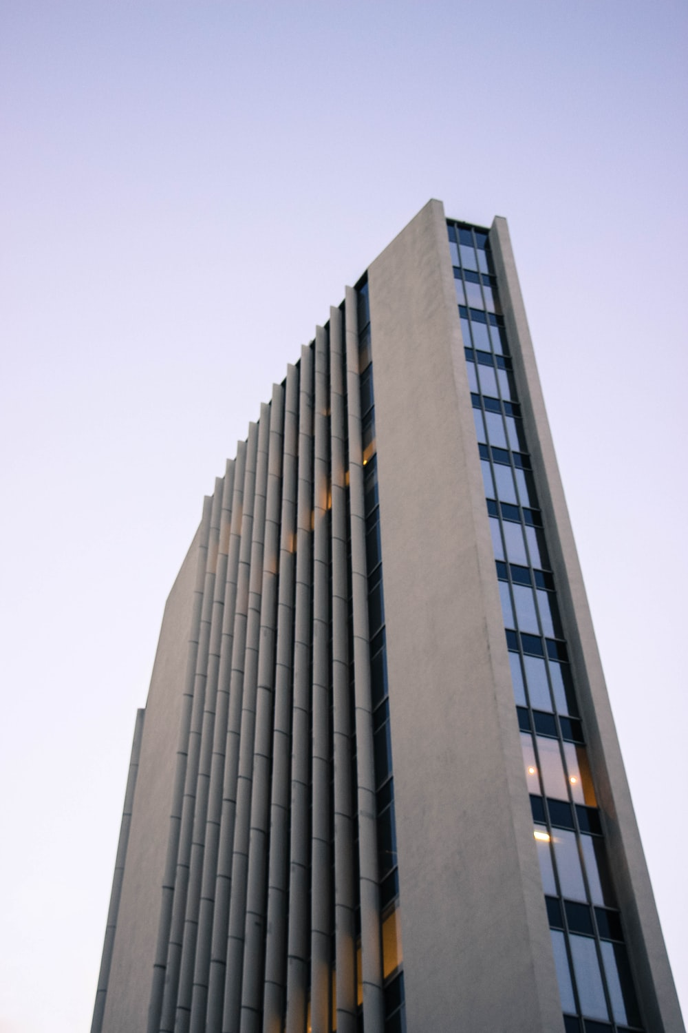 low-angle photography of flat building