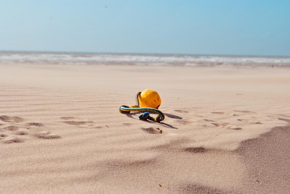 yellow ball on sand