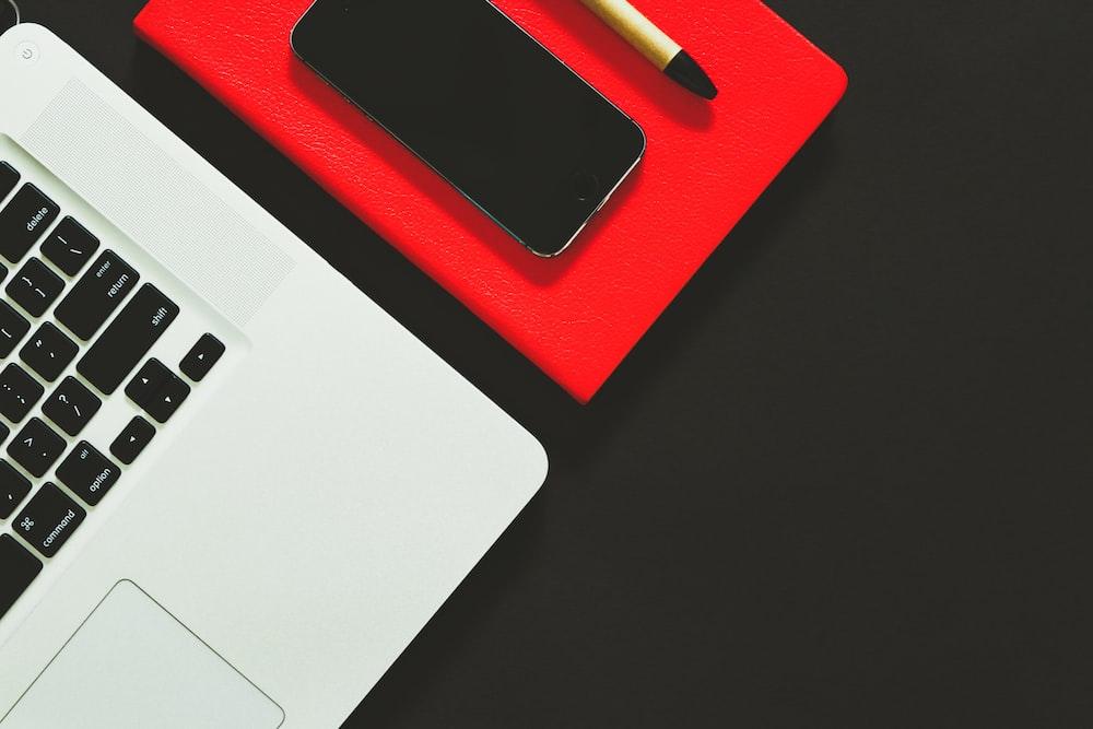 laptop beside smartphone