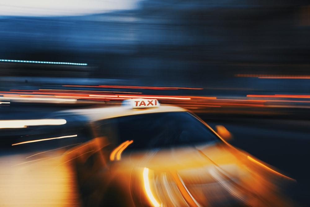 timelapse photography of orange vehicle