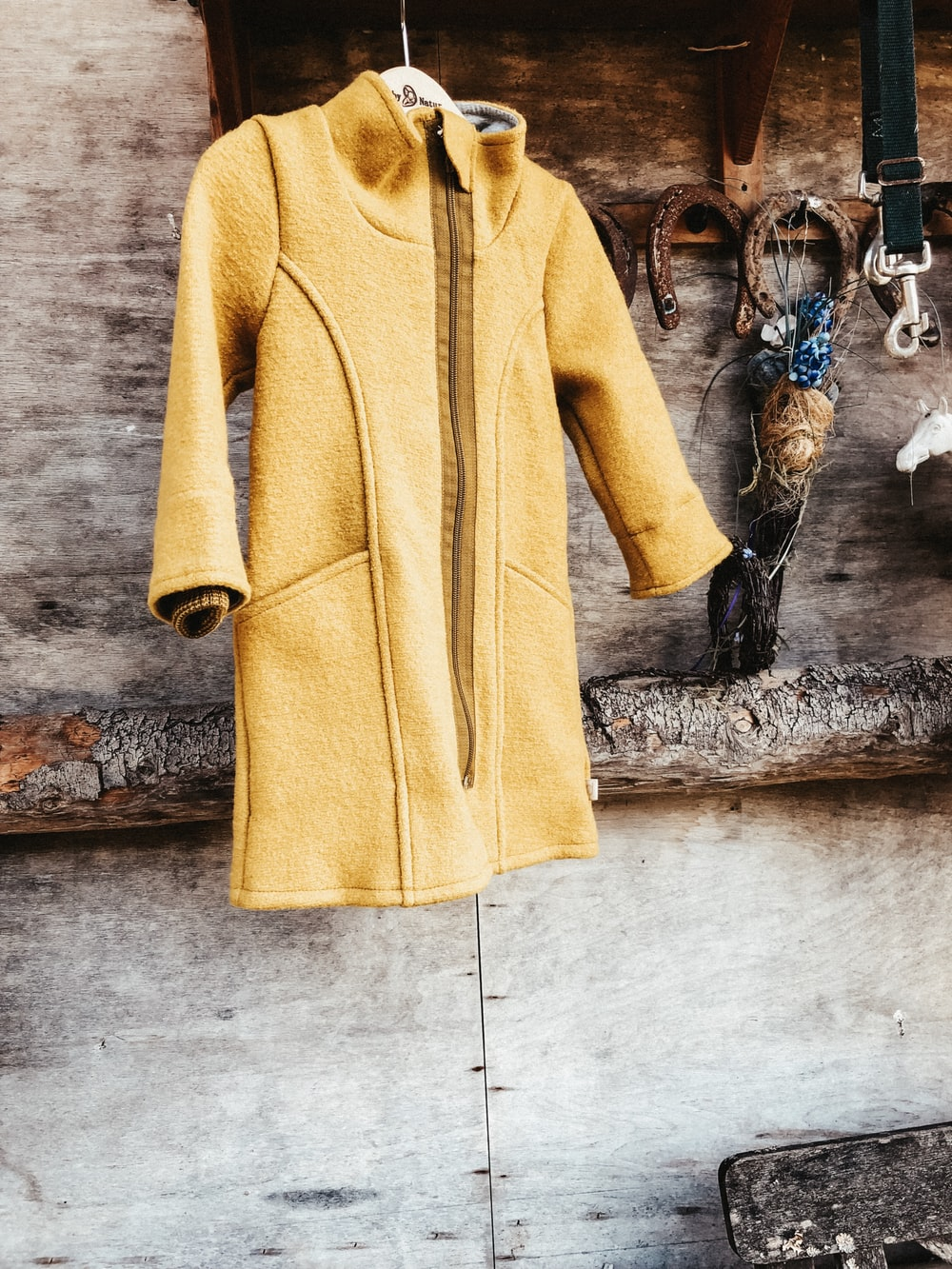 hanged yellow coat
