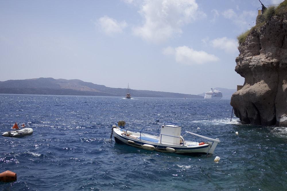 boat on body of water near island