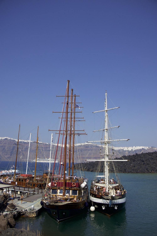 boats on body of water near island