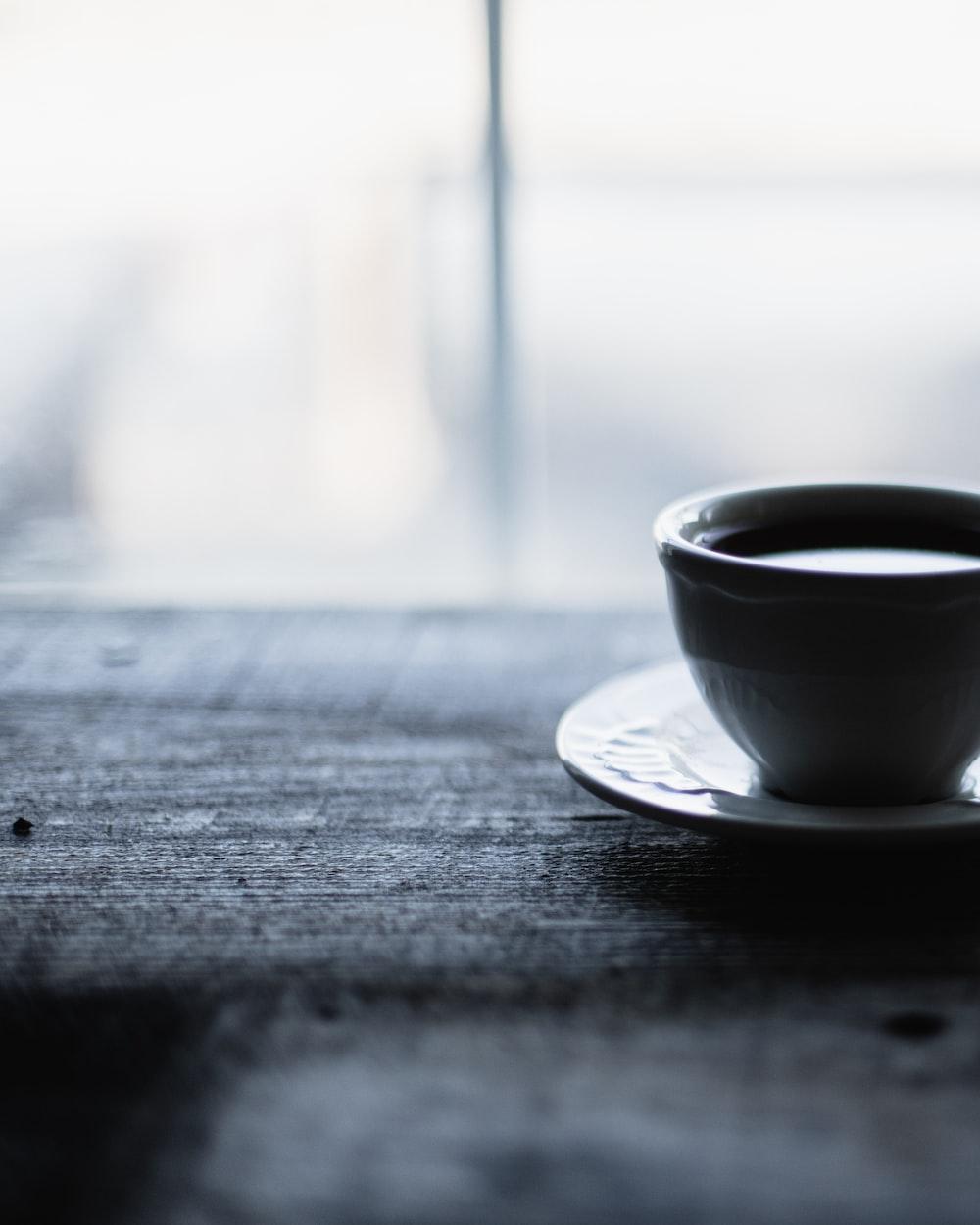 grayscale photo of ceramic mug