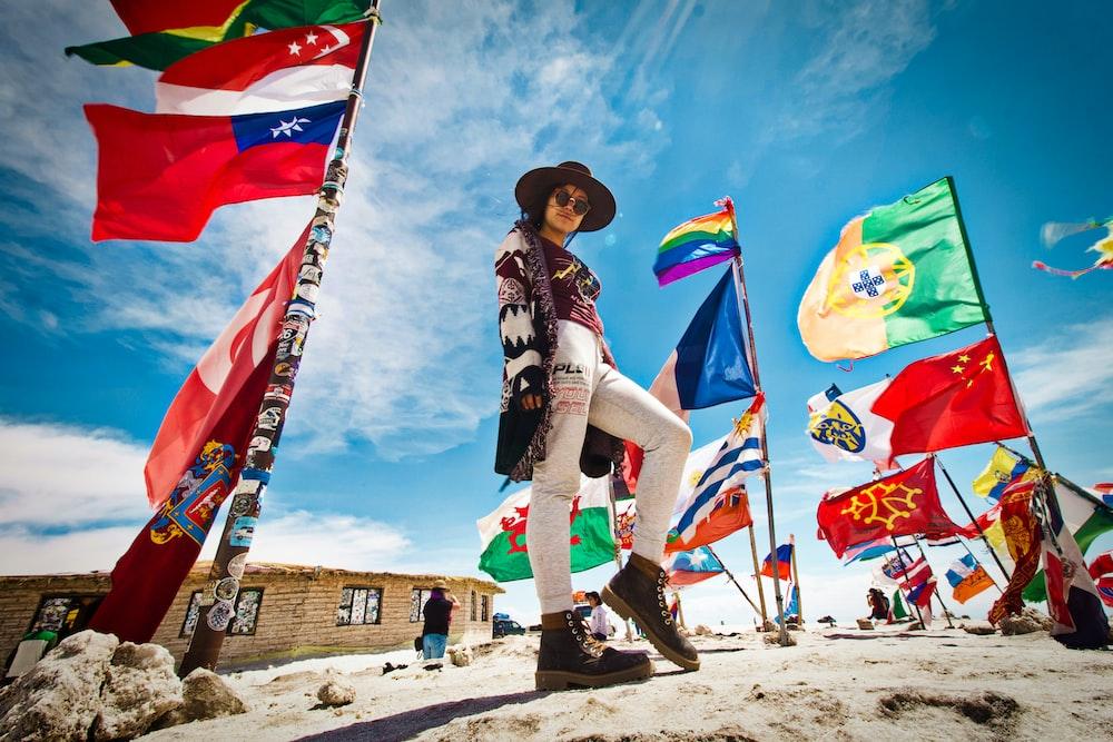 woman standing near flags
