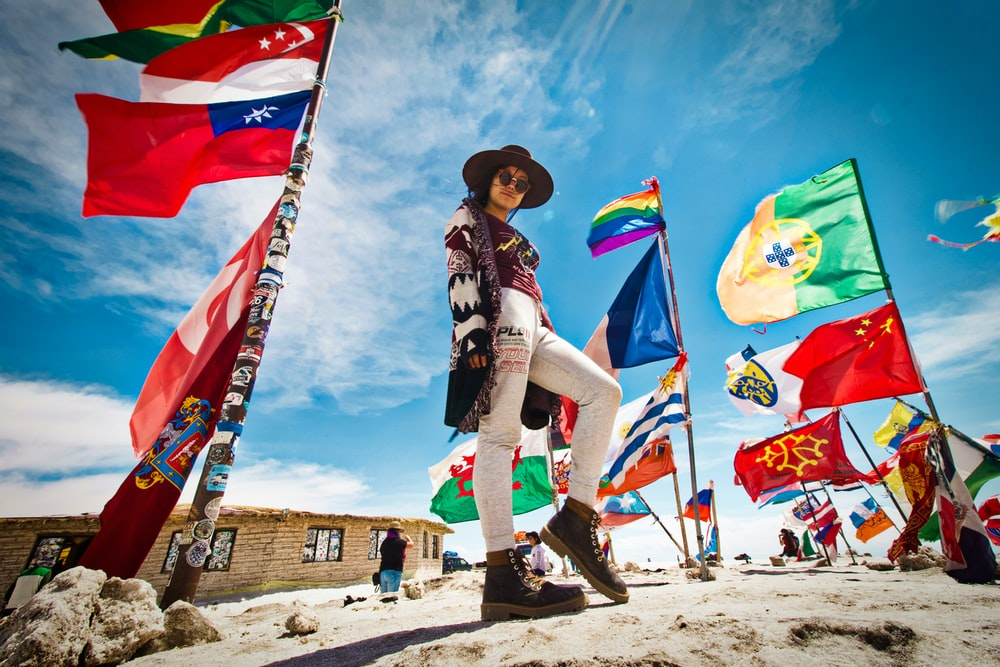 woman standing near flags